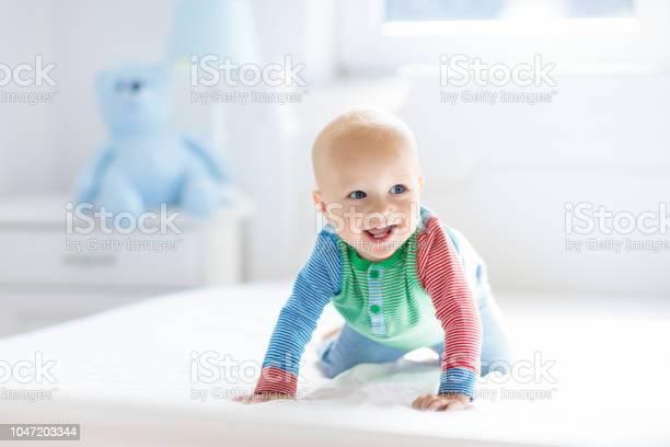 Baby boy crawling on bed picture id1047203344?b=1&k=6&m=1047203344&s=612x612&h=ho4odg6pyfbhndhjr rdbmdyugxyptp5yjb8v7e4grg=