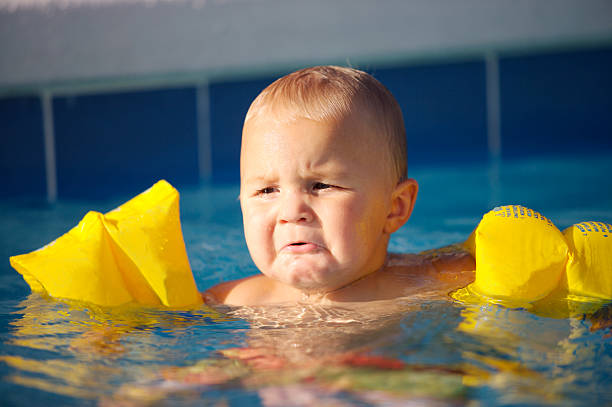 baby boy crying and not happy - frowning stock photos and pictures