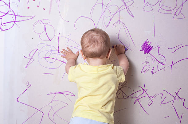 Making His Mark Artistically Stock Photo Baby Boy Drawing On Plasterboard Wall