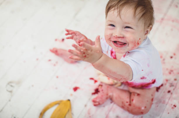 Baby Boy Eating Raspberries, Baby Led Weaning stock photo