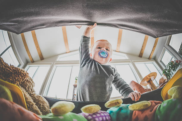 POV Baby Boy Exploring and Looking Inside Toy Box stock photo
