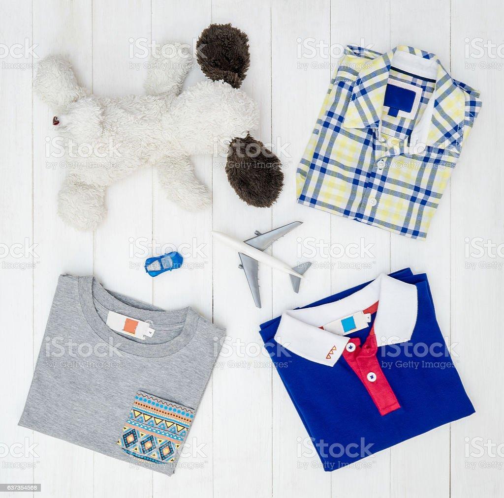 Baby boy fashion shirts flat lay on white wooden. stock photo