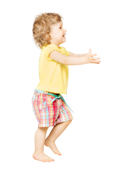 Baby Boy full length portrait, Happy Kid Playing on White, Funny Child One Year Old stock photo