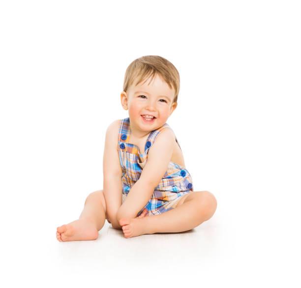 Baby Boy, Happy Toddler Kid Sitting on White, Smiling Infant Child Portrait stock photo