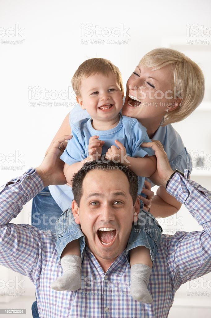 Baby boy having fun with parents royalty-free stock photo