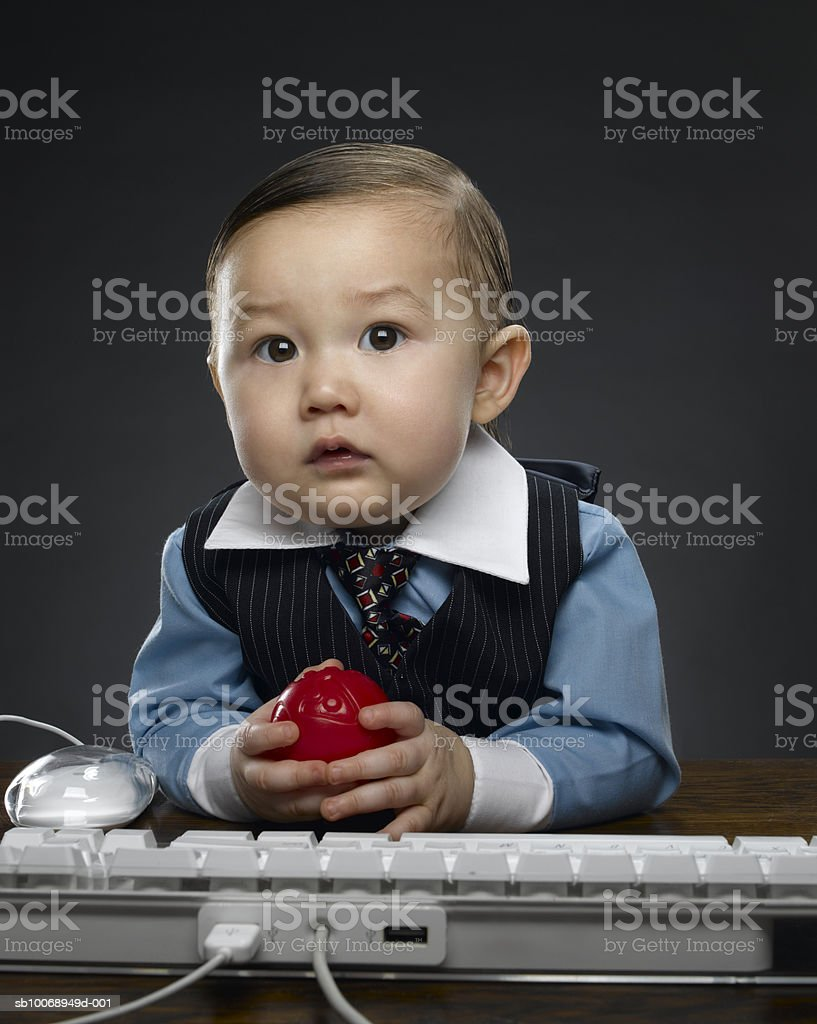 Baby boy (12-17 months) holding ball, portrait royalty-free 스톡 사진