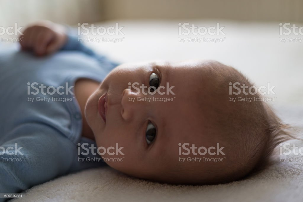 Baby boy in a blue bodysuit stock photo