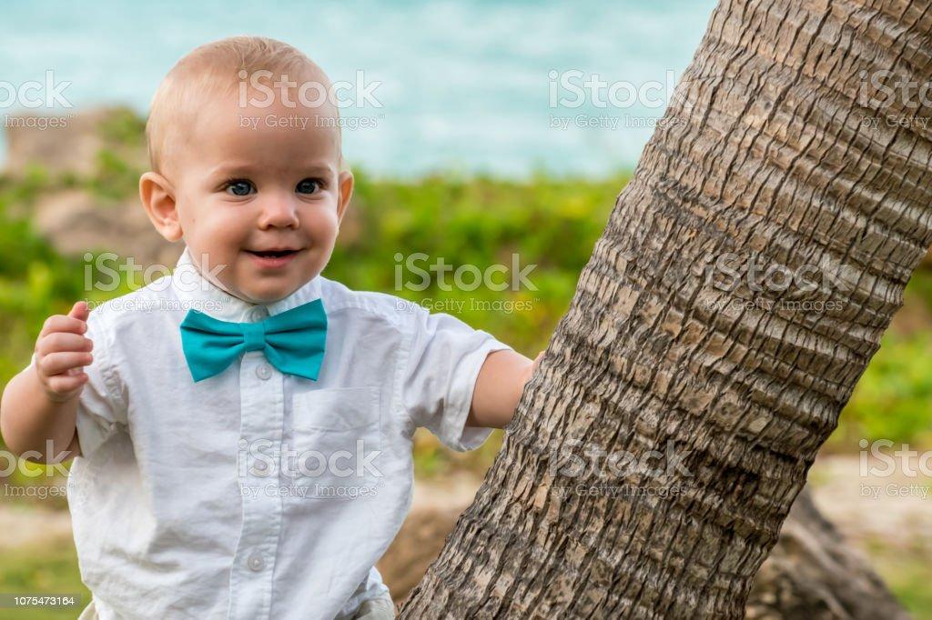 Baby boy in a wedding celebration stock photo
