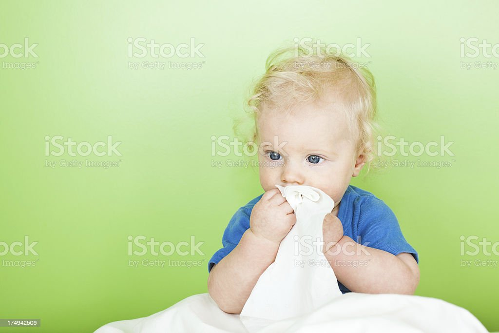 Baby boy in bed stock photo