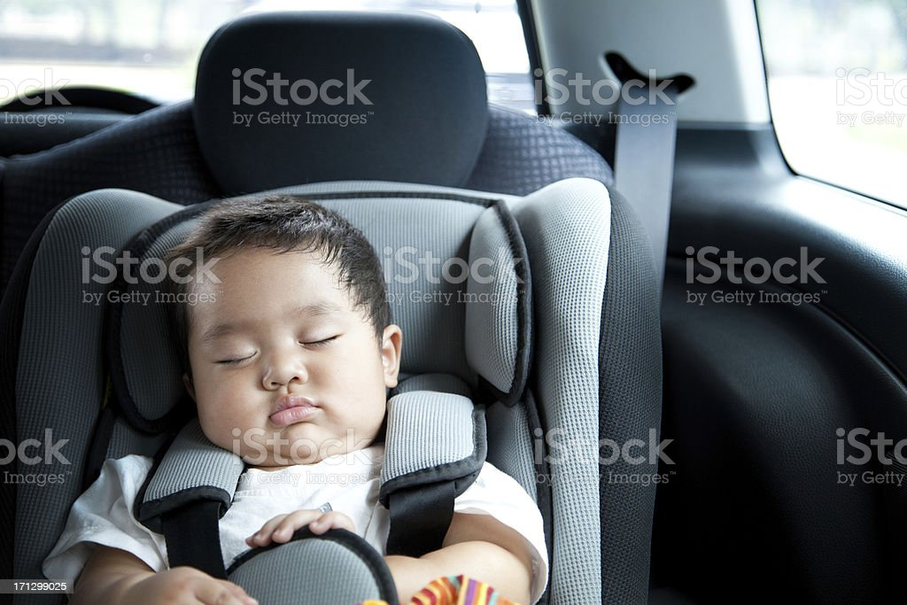 Baby boy in car seat stock photo