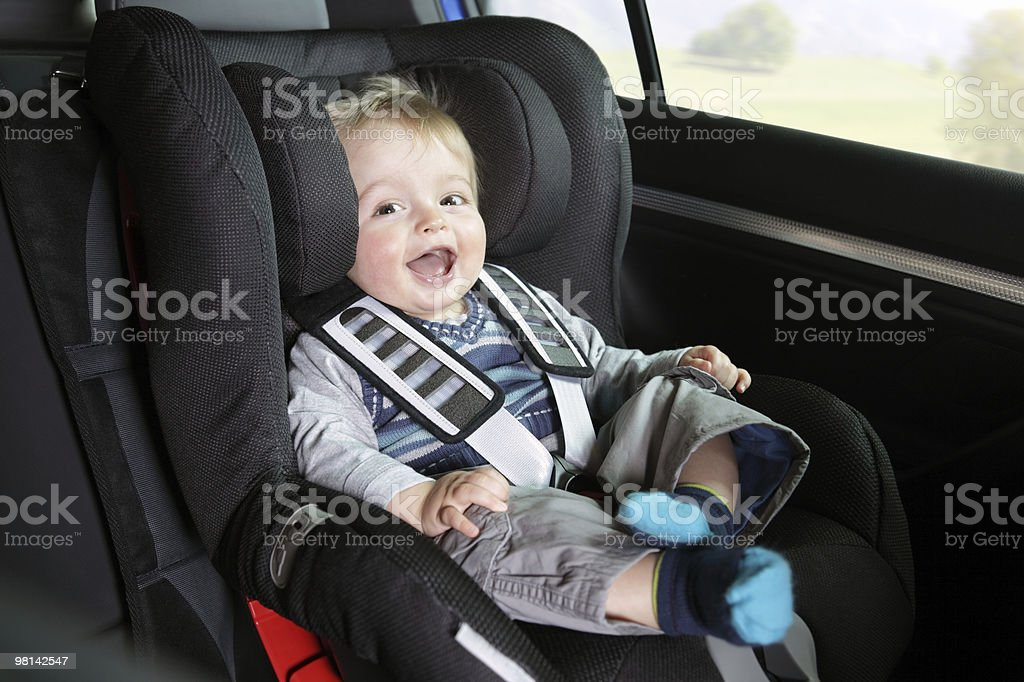 Baby boy in his child safety car seat royalty-free stock photo