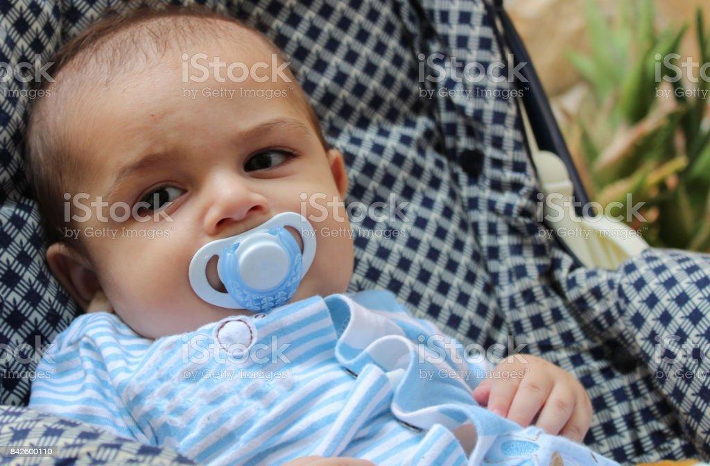 baby boy in pushchair stock photo
