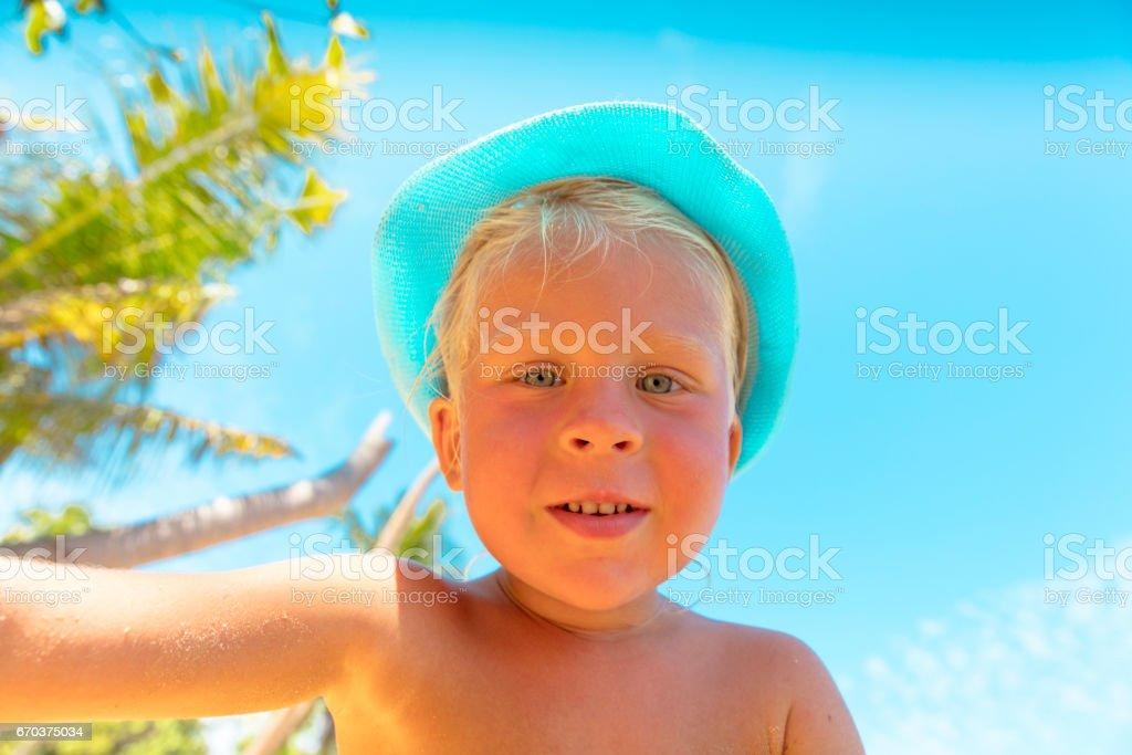 Baby boy in tropical beach stock photo