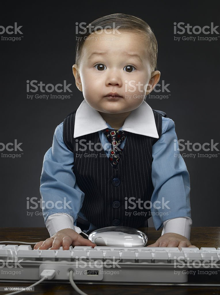 Baby boy (12-17 months) leaning over table, portrait royalty-free stock photo