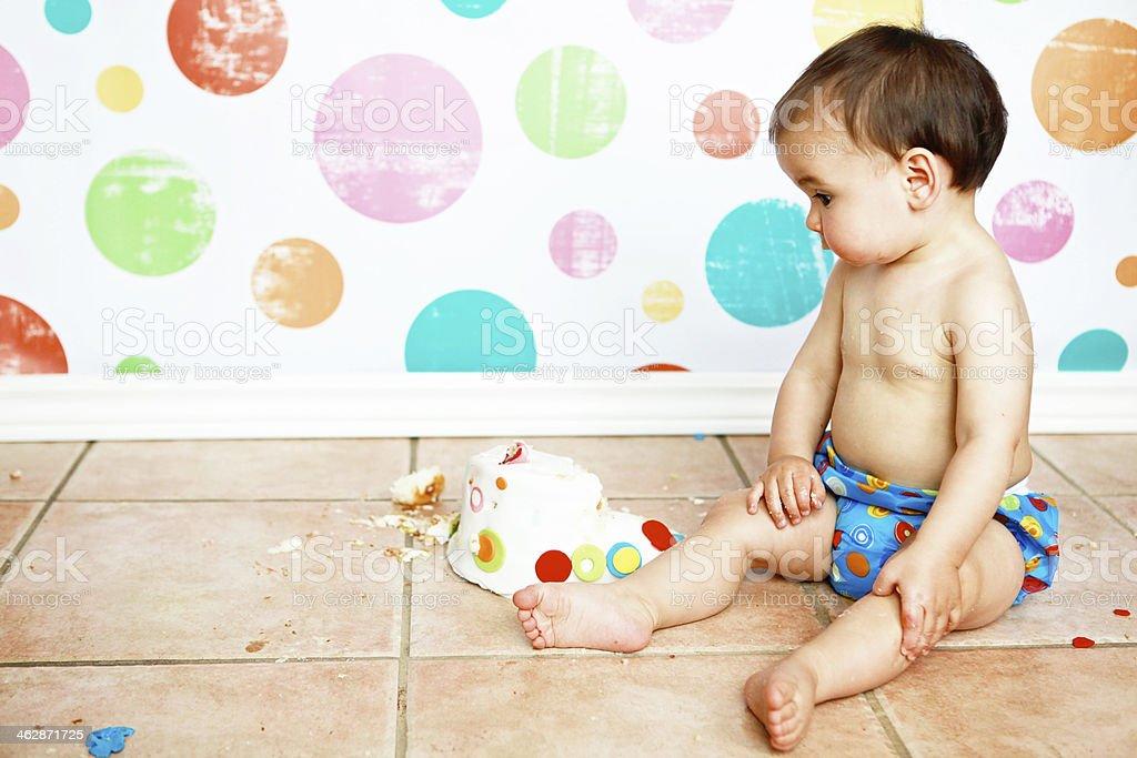 Baby Boy Looking At His Half Eaten Birthday Cake Royalty Free Stock Photo