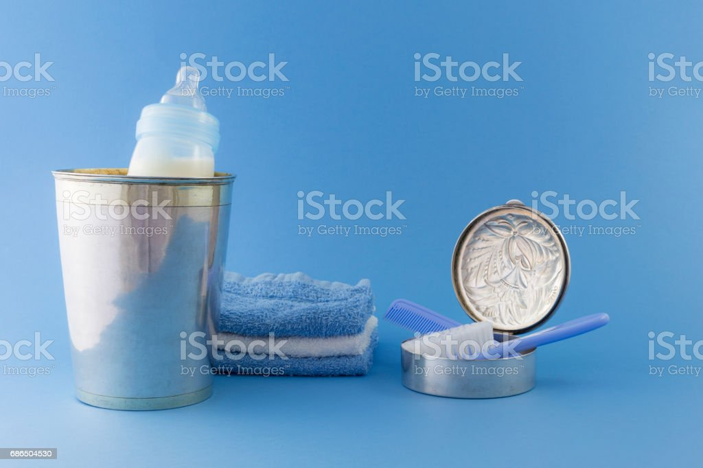 Baby boy luxury items on pale blue background foto stock royalty-free