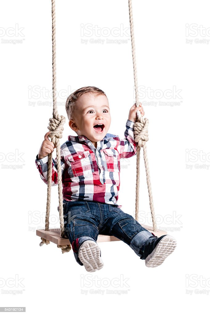 baby boy on a swing stock photo