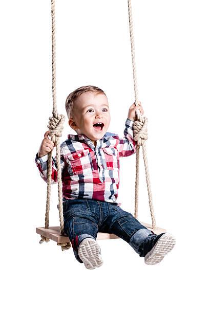 baby boy on a swing - schommelen bungelen stockfoto's en -beelden