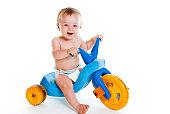 One year old baby sitting on an old trike. http://i283.photobucket.com/albums/kk281/jennibyron/Babies.jpg