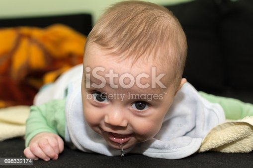 istock Baby boy on bed 698332174