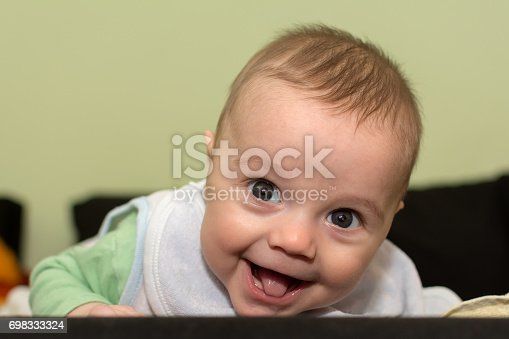 istock Baby boy on bed 698333324