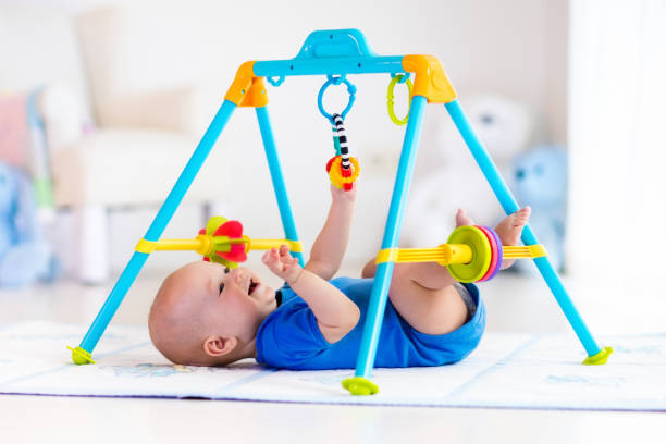 Baby boy on play mat. Child playing in gym.圖像檔
