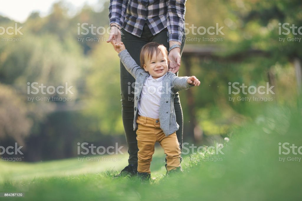 Baby boy outdoors in nature learning to walk royalty-free stock photo