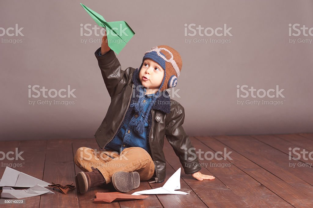 Baby boy playing in room stock photo