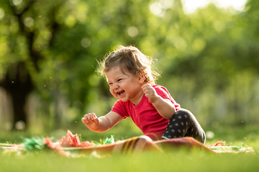 Baby Boy Playing In The Grass Stock Photo - Download Image Now