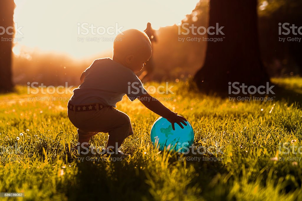 Baby boy playing in the park royalty-free stock photo