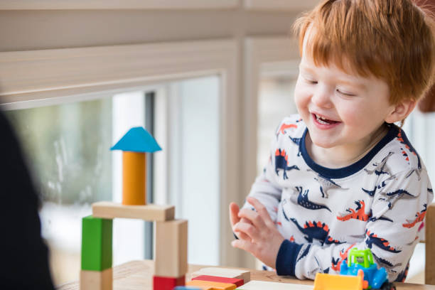 Baby Boy Playing with Colorful Blocks stock photo