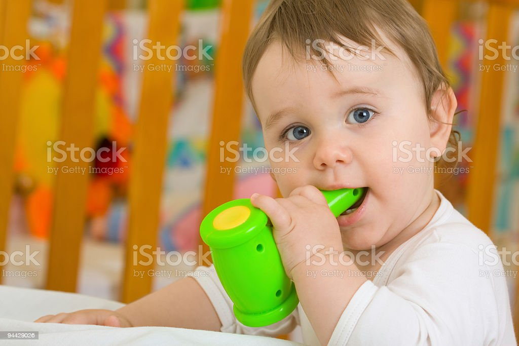 Baby boy playing with hammer toy royalty-free stock photo