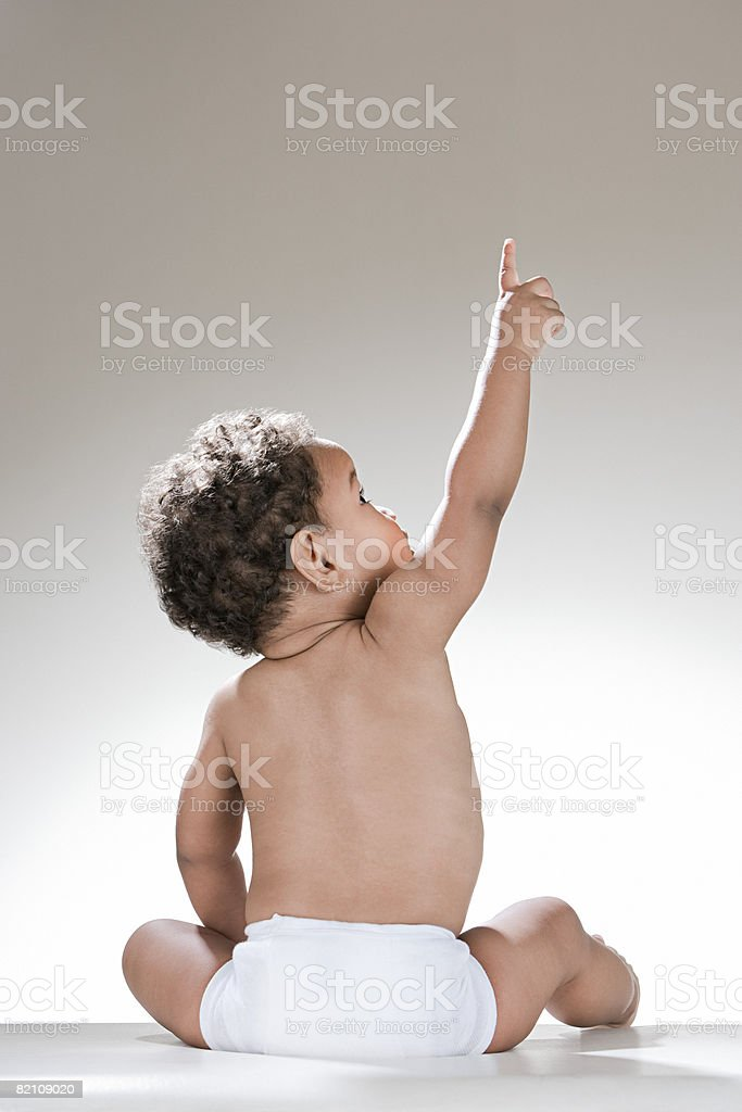 A baby boy pointing stock photo