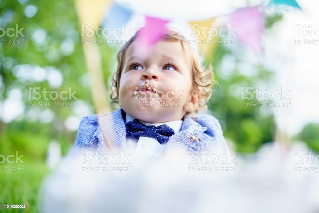 Baby Boy Poking Finger In His First Birthday Cake Stock Photo More