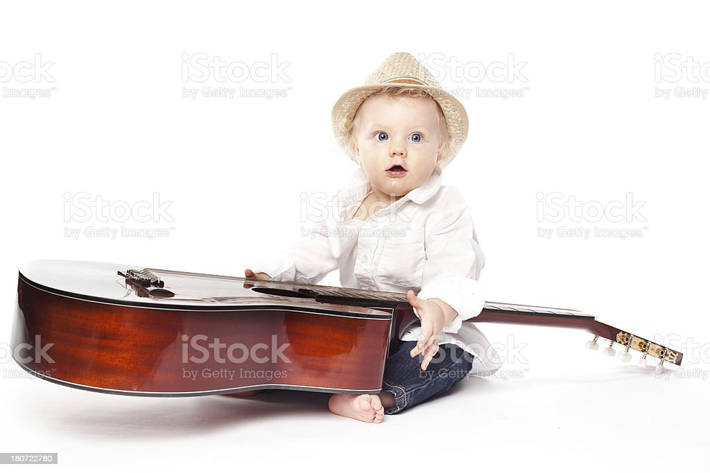 Baby boy posing with guitar royalty-free stock photo