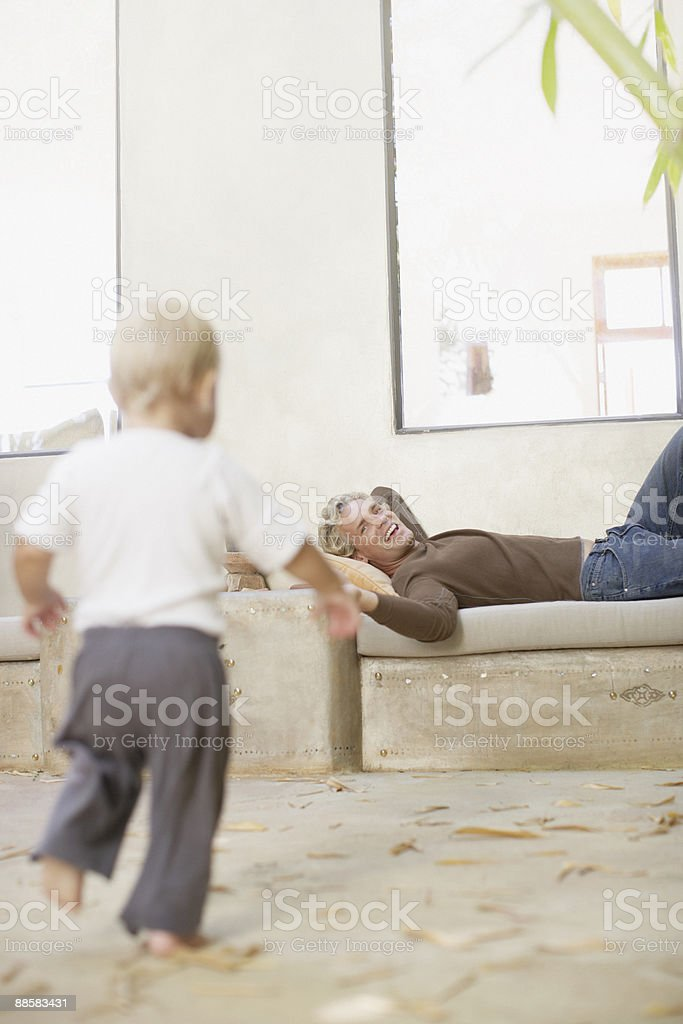 Baby boy running to father royalty-free stock photo