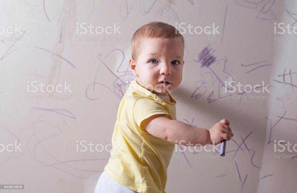 Baby boy scrawling writing stock photo