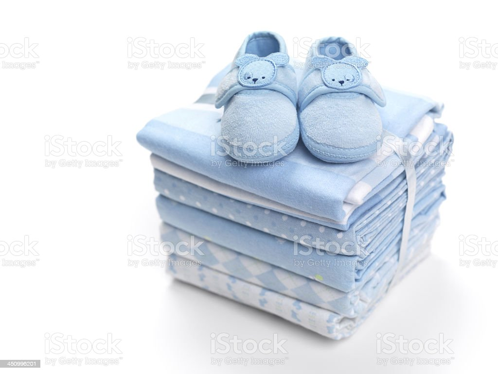 Baby boy shoes on blankets stock photo