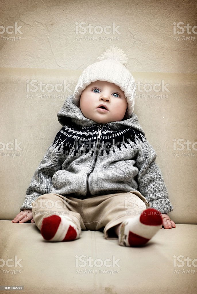 Baby Boy Sitting Up with Warm Hat On stock photo