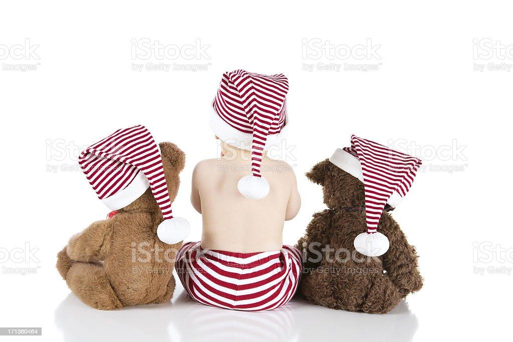 Baby Boy Sitting With Teddy Bears and Wearing Santa Hat stok fotoğrafı