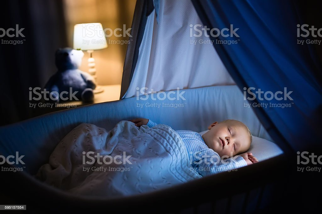 Baby boy sleeping at night stock photo