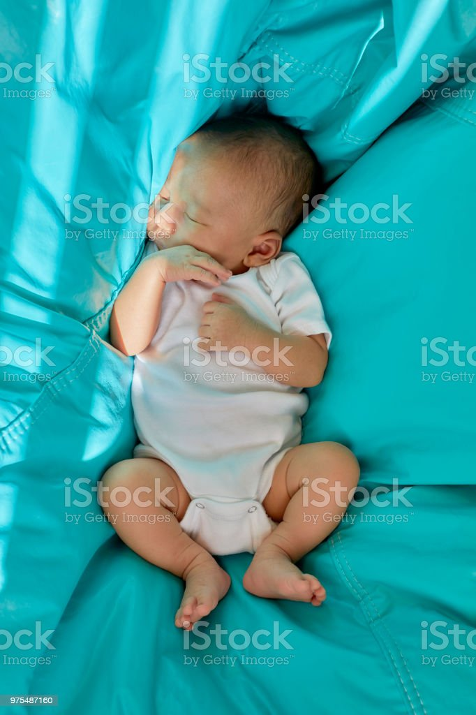 Incredible Baby Boy Sleeping In A Bean Bag Stock Photo Download Image Machost Co Dining Chair Design Ideas Machostcouk