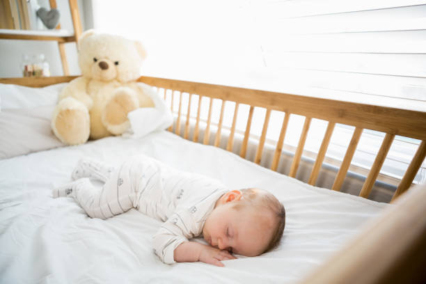 Baby boy sleeping on a cradle stock photo