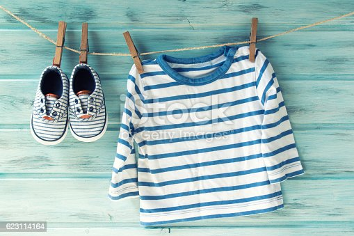 istock Baby boy striped shirt and baby shoes, vintage filter 623114164