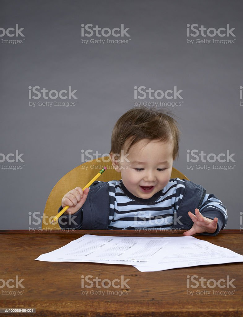 Baby boy (12-17 months) studying royalty-free stock photo