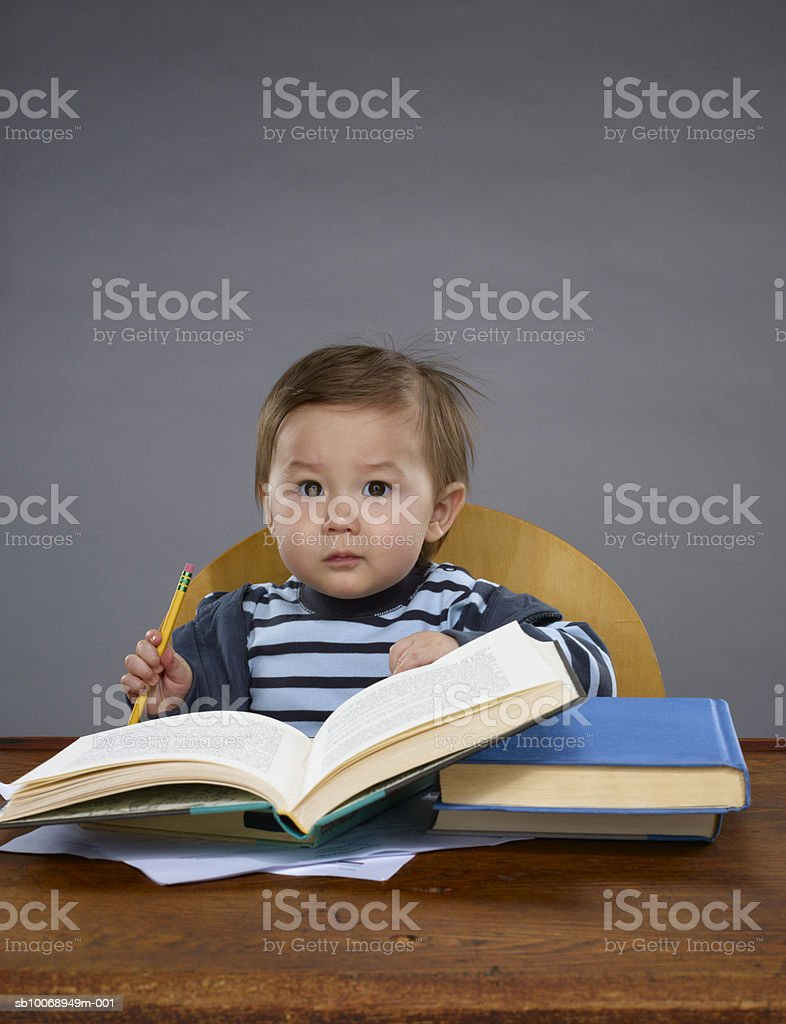 Baby boy (12-17 months) studying, portrait royalty-free stock photo