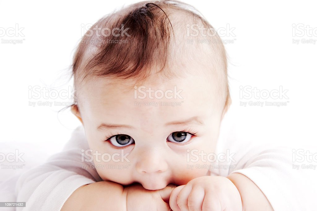 Baby Boy Sucks on His Fingers Closeup Headshot stock photo