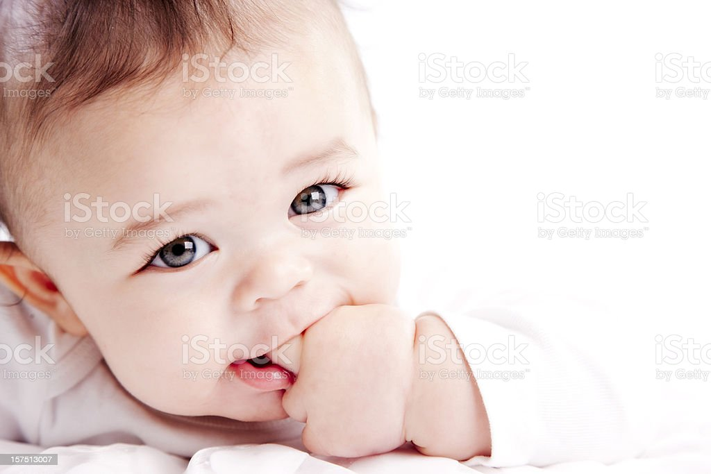 Baby Boy Sucks on His Fingers stock photo