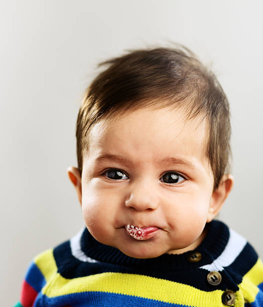 baby boy sulking - human saliva stock pictures, royalty-free photos & images