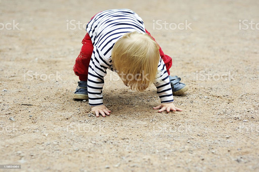 Baby boy trying to stand up stock photo